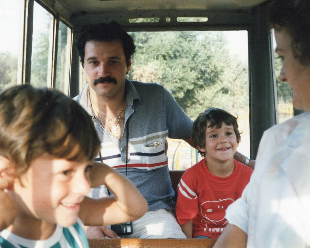 Maurizio as a child with dad, brother and mom