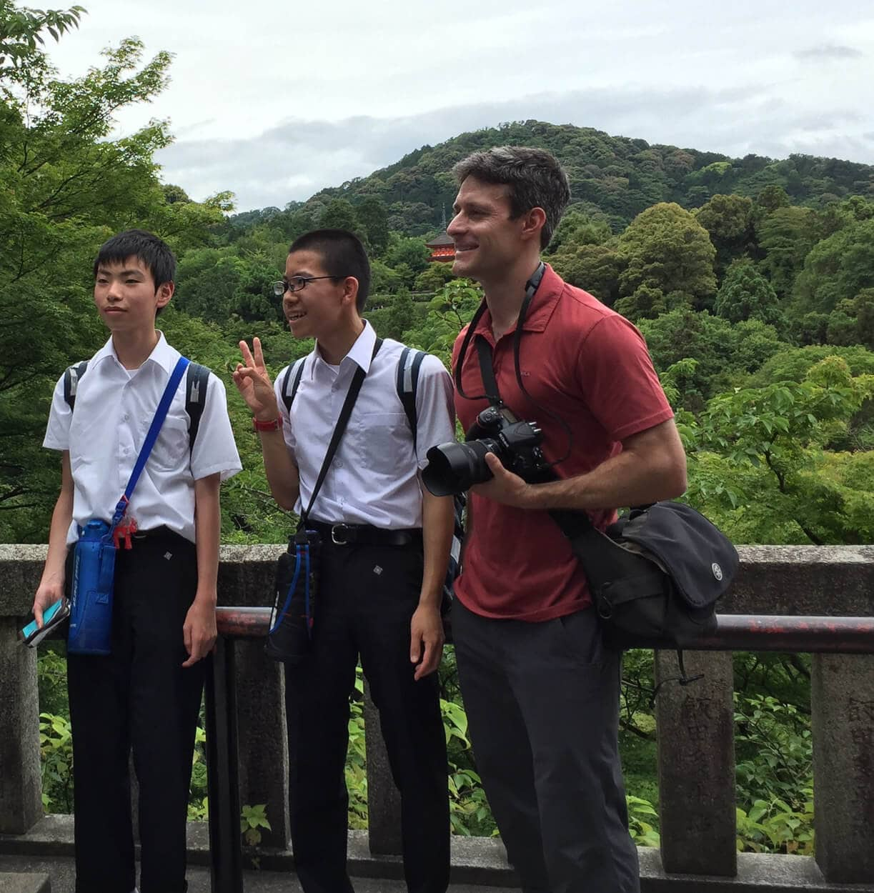 Me helping Japanese students while traveling through Japan