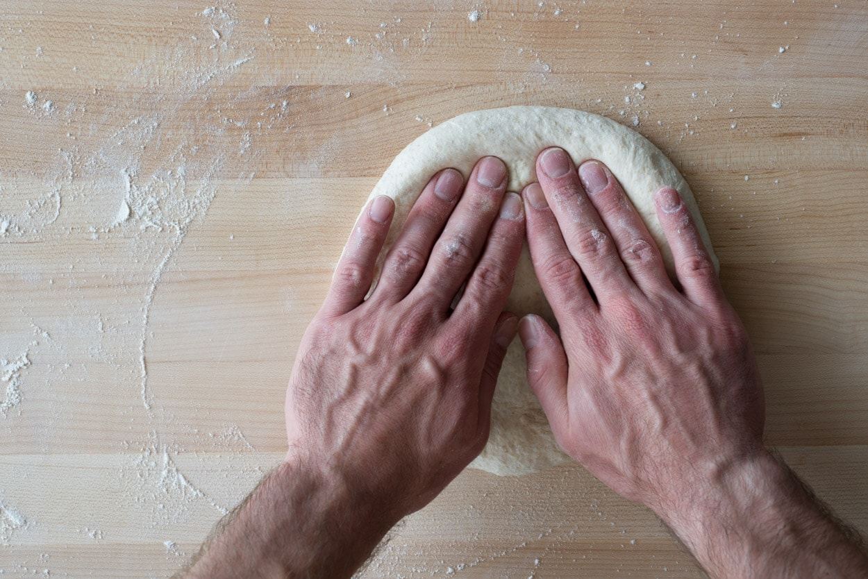 shaping sourdough pizza disc