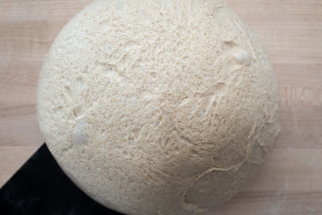 A More Whole Wheat Sourdough Pizza Dough via @theperfectloaf