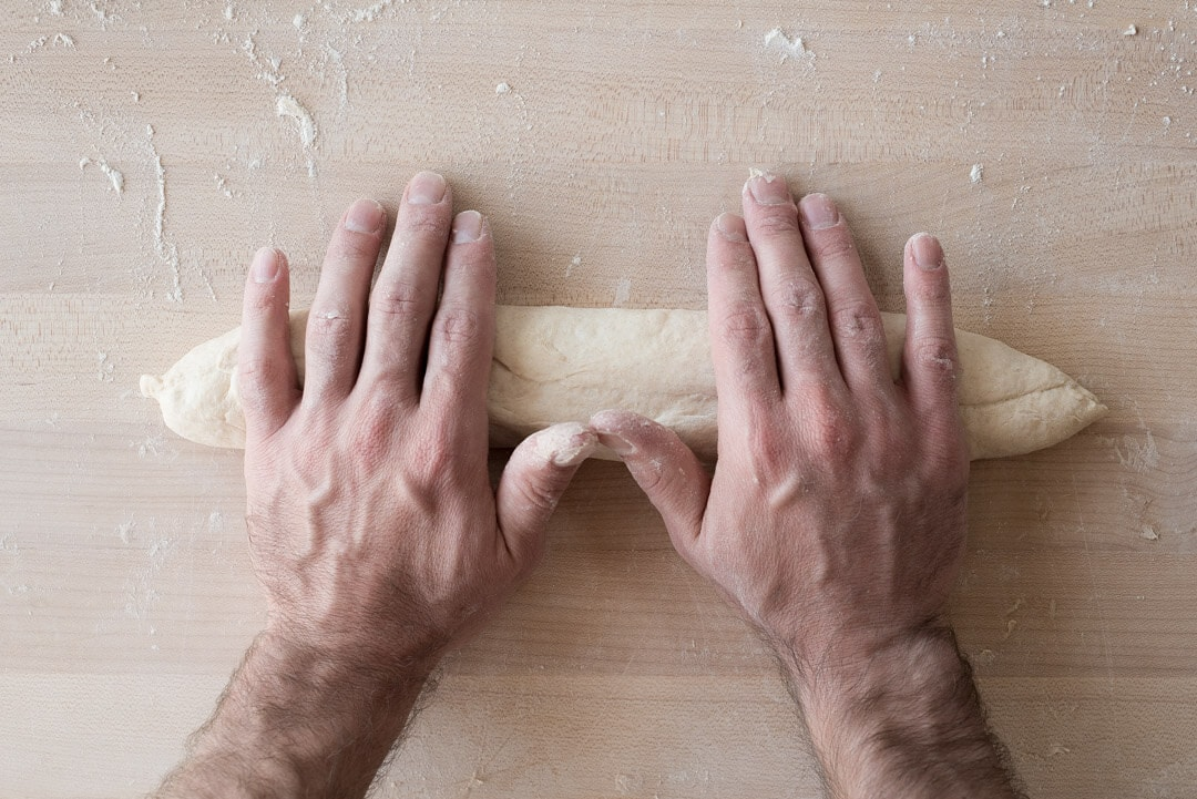 Baguette dough being shaped