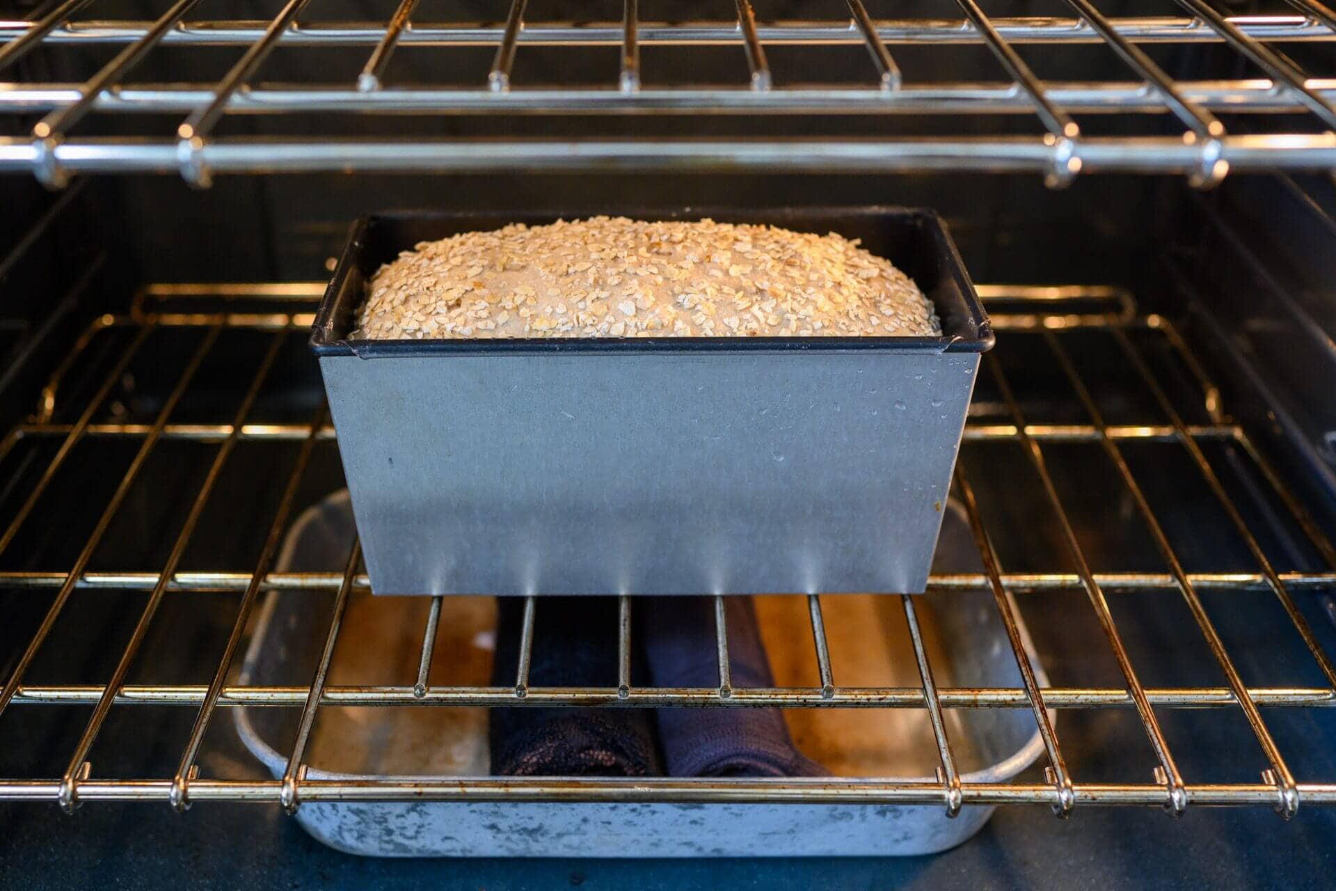 Honey whole wheat dough baking in oven with steam