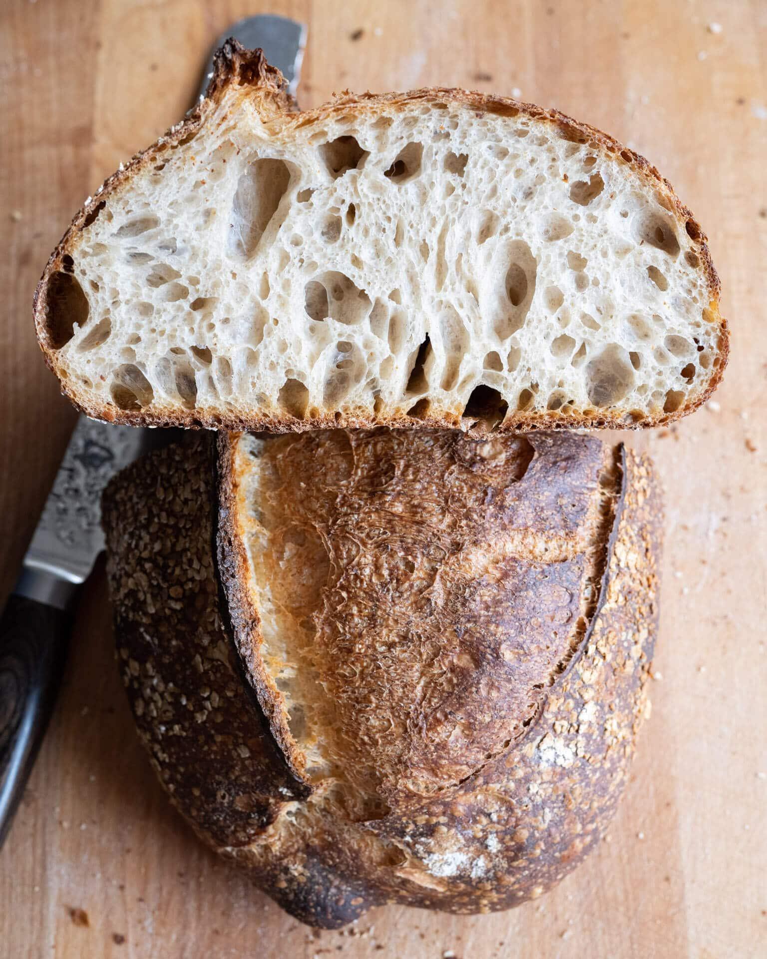 Cut sourdough bread on cutting board