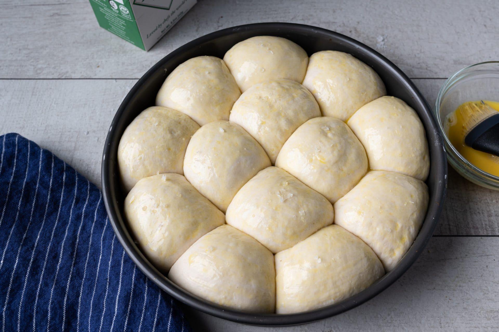 Super soft sourdough dinner rolls ready for the oven