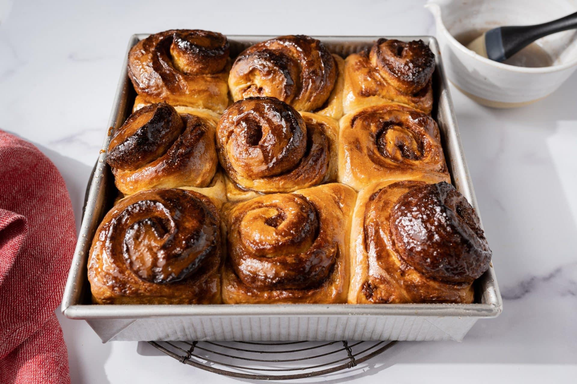 Cardamom rolls glazed with simple syrup