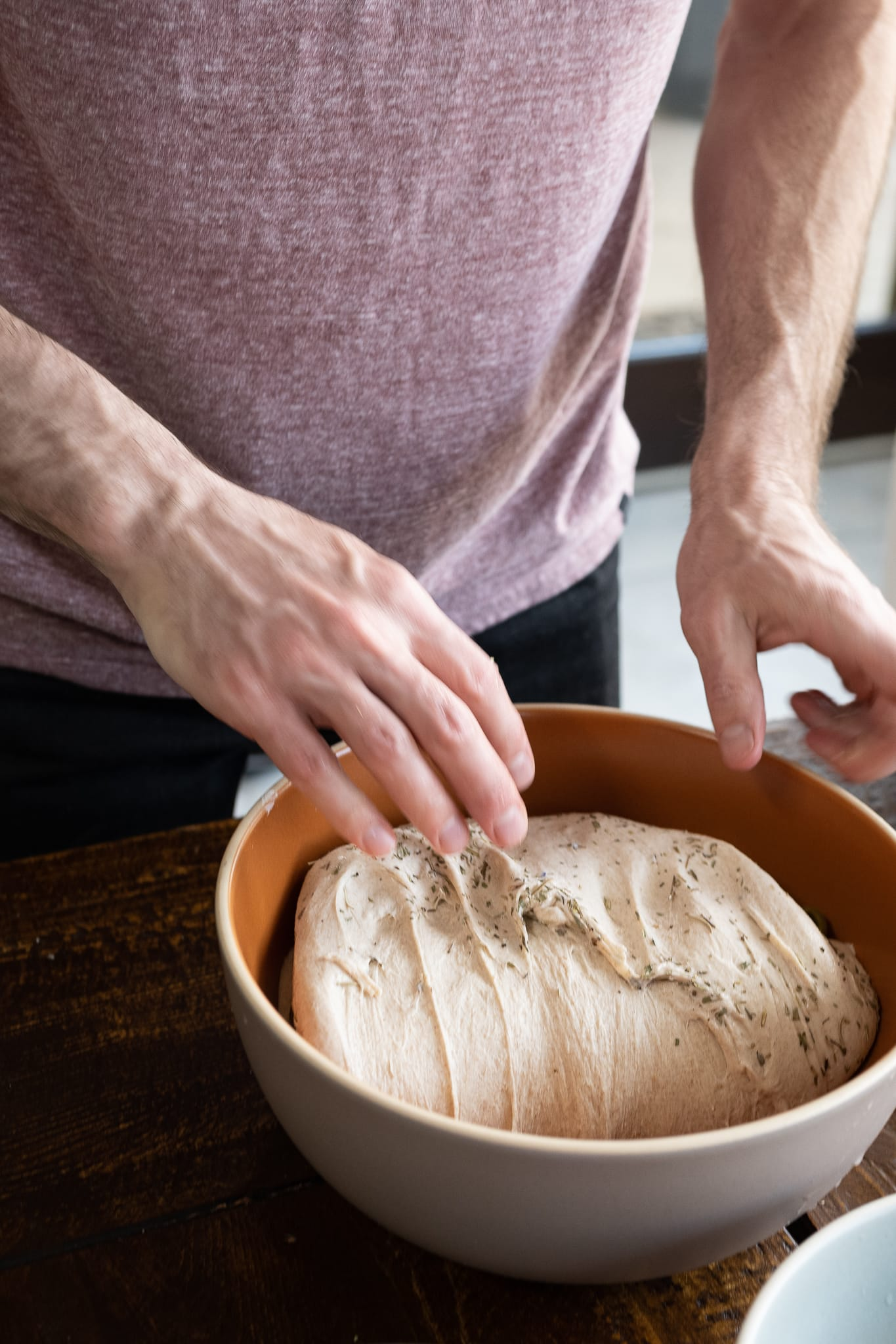 stretching and folding green olive and herb sourdough bread