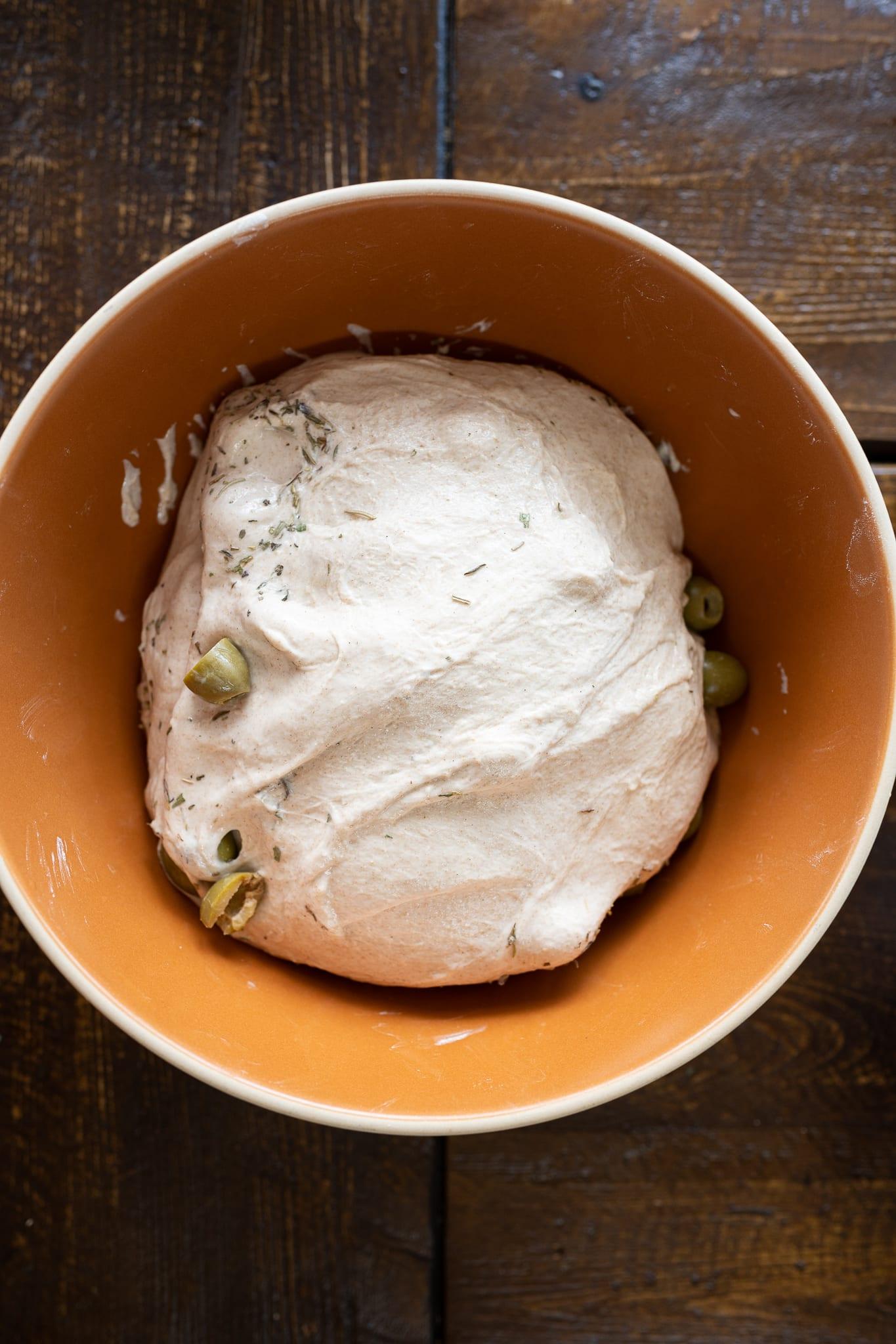 green olive and herb sourdough bread in bulk fermentation
