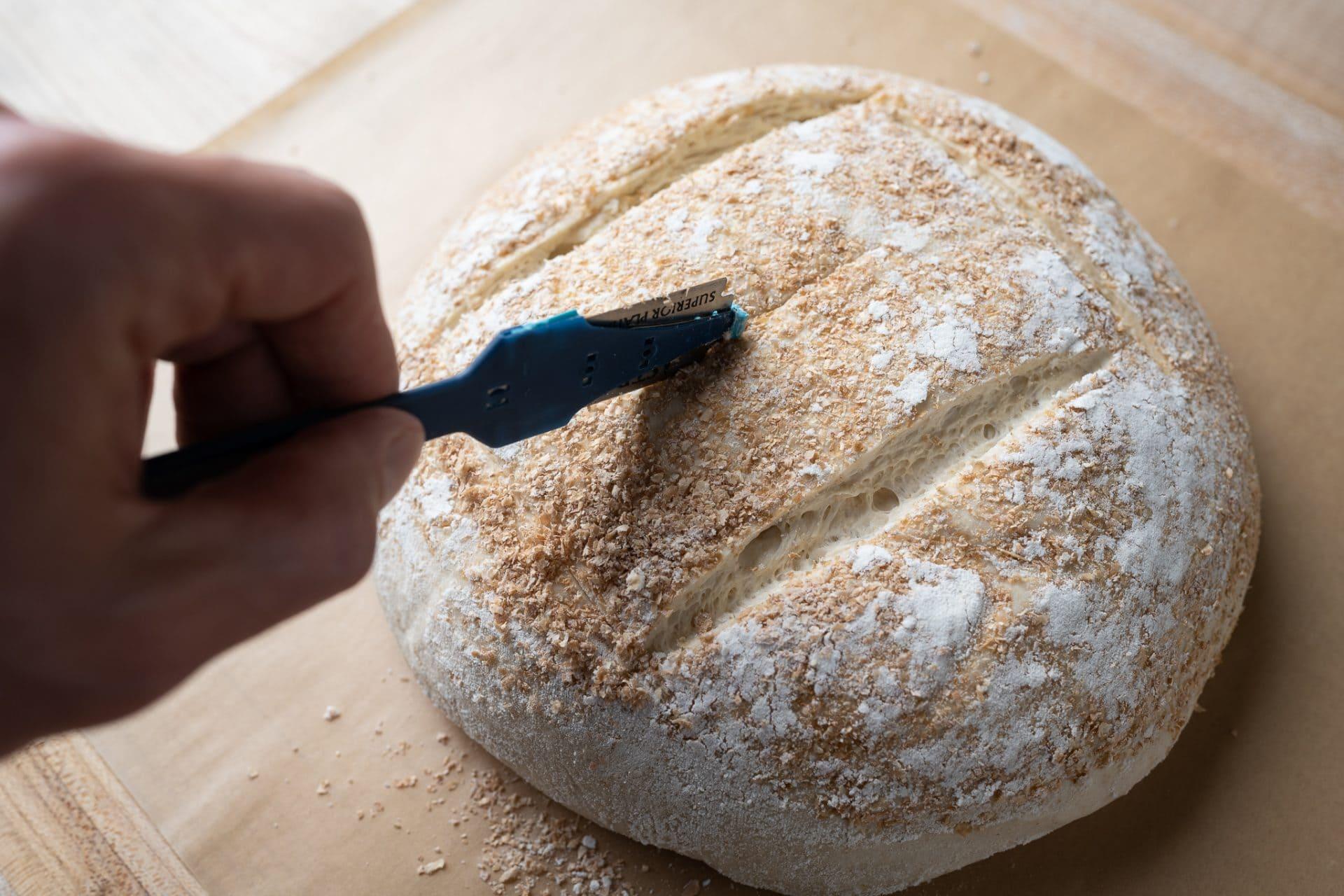Scoring sourdough bread dough